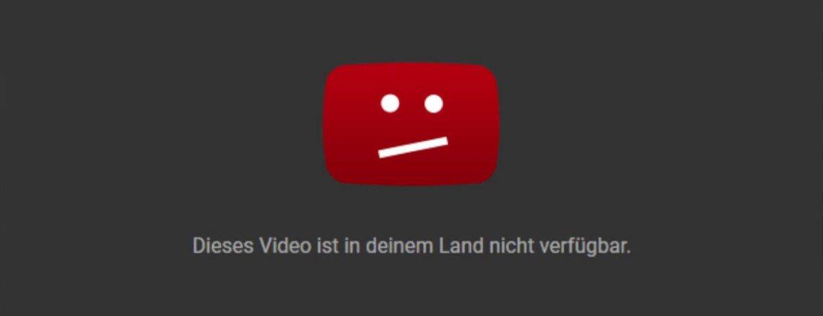 Eine Fehlermeldung, die einen unzufriedenen Emoji zeigt, Beschriftung: Dieses Video ist in deinem Land nicht verfügbar